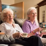 Two elderly ladies having tea