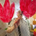 An old man painting on glass