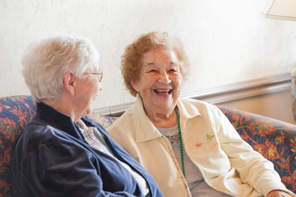 Two Elderly womans are laughing