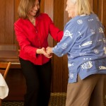 A woman and an old lady dancing