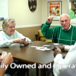 Elderly people playing a card game