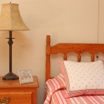 A bed and a bedside table with a lamp