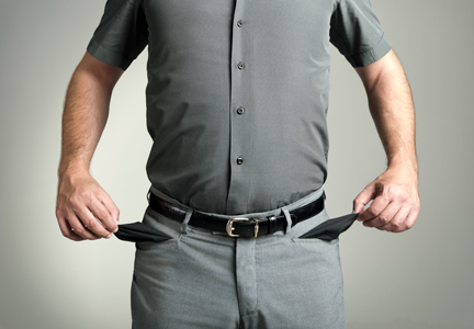 Man showing his pockets are empty and has no money to pay for his parent's retirement home expense
