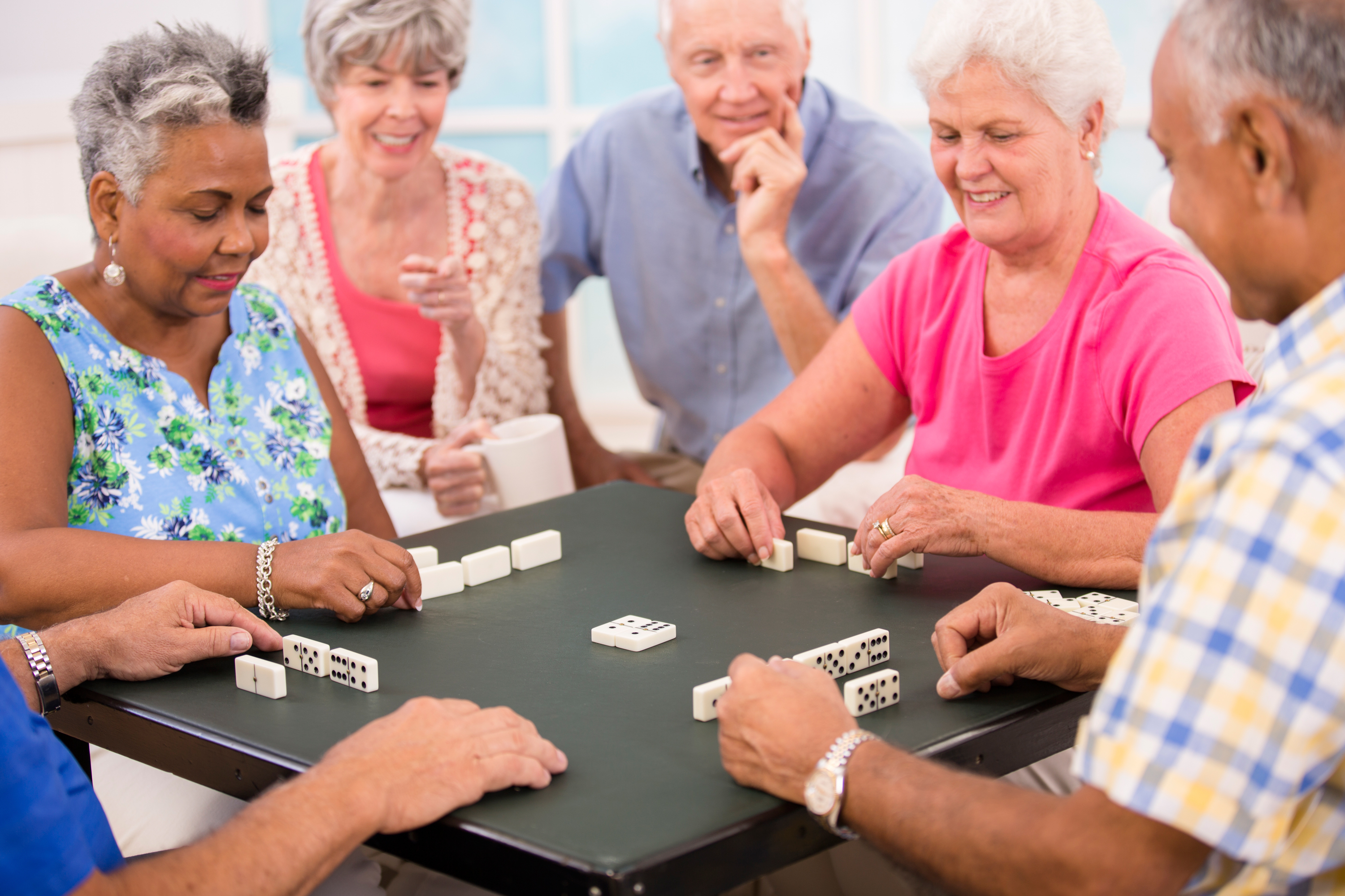 Senior Adult Friends Playing Dominoes