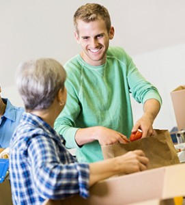 A man helping his senior loved one with packing