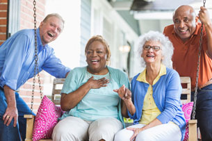 Group of multiracial seniors on porch swing