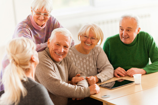 Senior people socializing in an assisted living facility