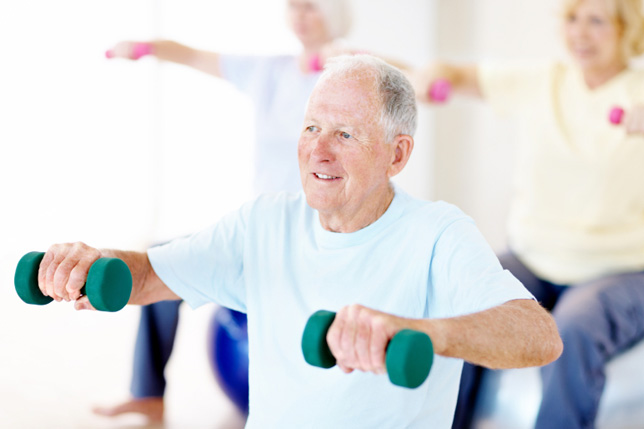 A senior man exercising at an independent living residence gym