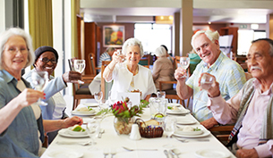 Retired Seniors Enjoying Lunch at Assisted Living Facility