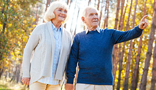 Senior Couple Taking a walk through Forest