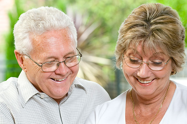 Mature couple looking at a document featured image