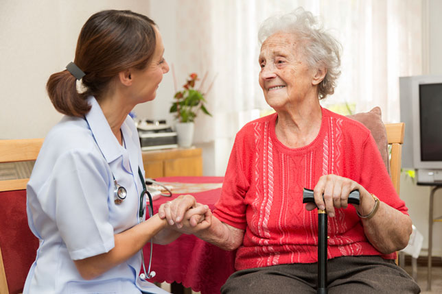 Nurse during home visit with senior woman featured image