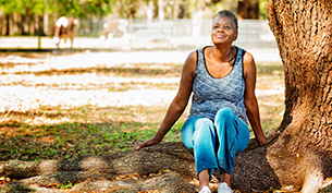 Senior African American Woman Relaxing by a Tree
