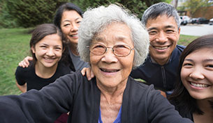 Grandmother Children and Grandchildren Pose for a Family Selfie