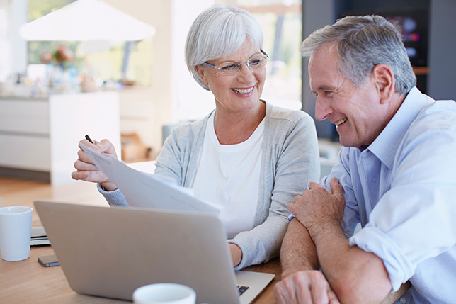 A Senior Couple Reviewing Their Retirement Saving Status