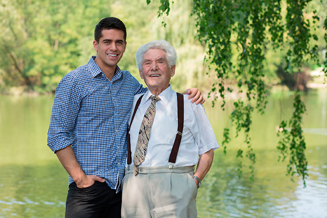 Old Man With His Young Son Before Moving To Assisted Living Facility
