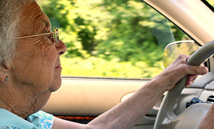 Senior Citizen Woman Driving a Car