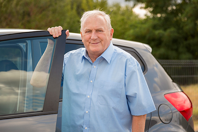 Senior Male Driver Standing Outside His Car with Door Open
