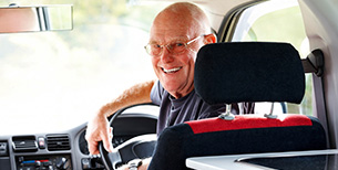 Senior Man Sitting in his Campervan Ready for an Outdoor Activity