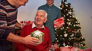 Senior Residents at Retirement Residence Exchanging Holiday Gifts With Each Other