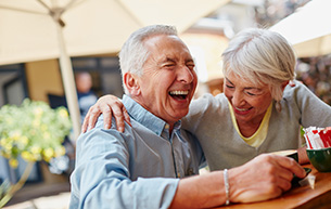 A Senior Couple Having a Laugh at a Skilled Nursing Center