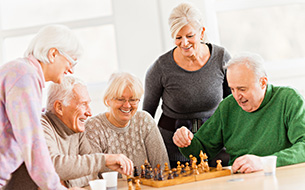 Senior People Playing Chess at Independent Living Facility in Wyndemere Woods