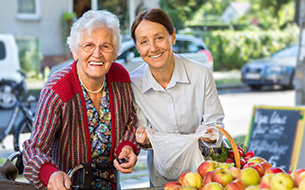 Senior Woman Going For Grocery Shopping With Caregiver