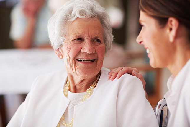 Our Expert at Wyndemere Woods Facility Assisting a Senior Resident Lady