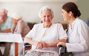 Happy Senior Woman At Nursing Home