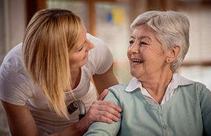 Nurse during home visit with senior woman at an assisted living facility