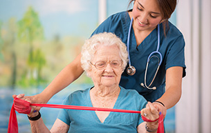 Nurse does physical therapy at a retirement community