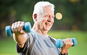 Senior man exercising outdoors in a retirement community